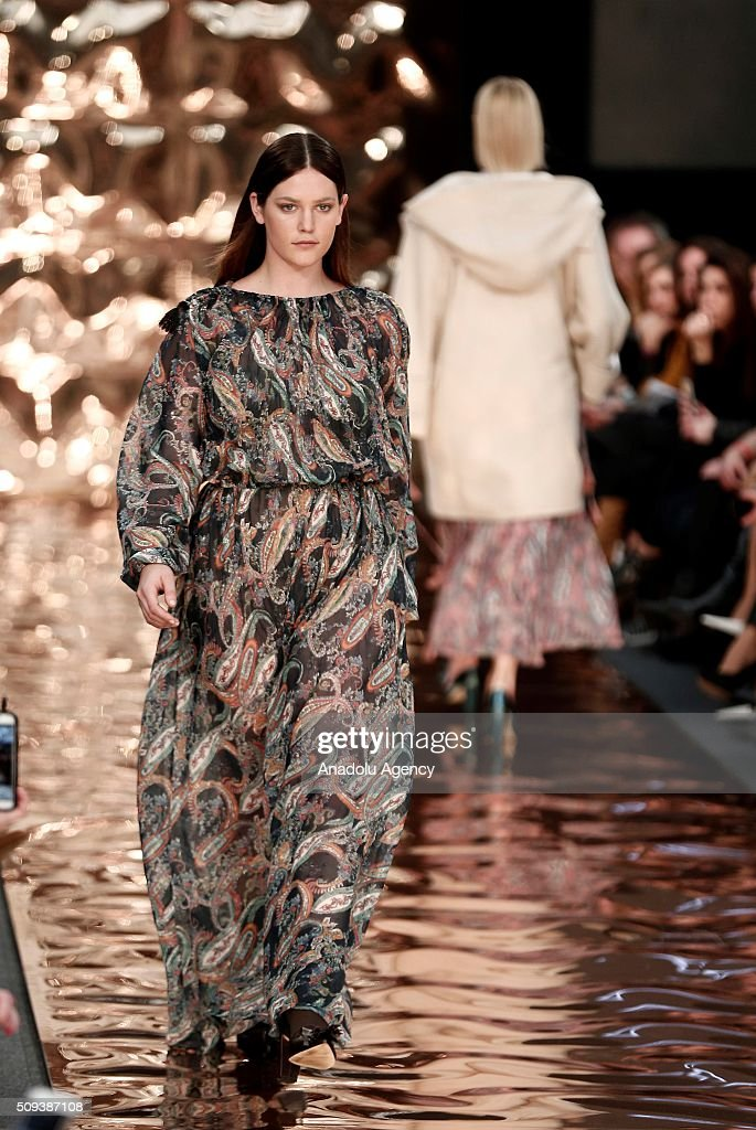 A model wears a creation of Couchel's fall-winter 2016/2017 fashion collection presented at the Madrid Fashion Week 2016 on February 10, 2016 in Madrid, Spain.