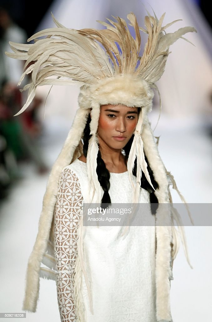 A model wears a creation of David Christian's fall-winter 2016/2017 fashion collection presented at the Madrid Fashion Week 2016 on February 9, 2016 in Madrid, Spain.