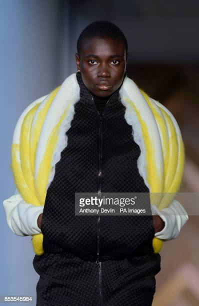 A model wears a design by Nam Jung Choi during the Royal College of Art's Graduate Fashion show at the Royal College of Art London Show