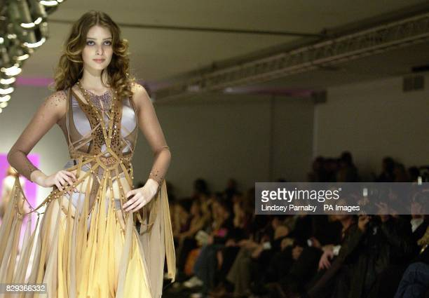 A model wears a designs by students during the Lancome Colour Design Awards at the former Saatchi Gallery in central London held in aid of Sargeant...