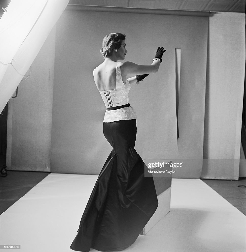 Black gloves for gown - A Model Wears A Fomal Satin Gown Designed By Mainbocher With Matching Black Gloves