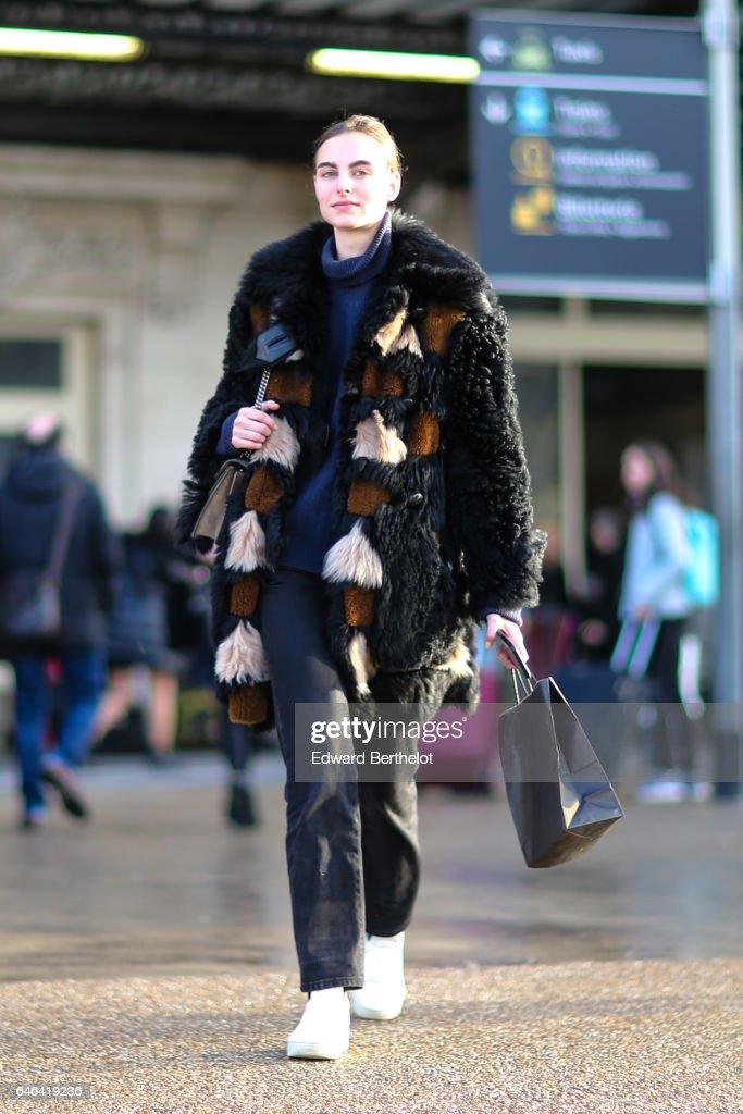 A model wears a fur coat, outside the Olivier Theyskens show, during Paris Fashion Week Womenswear Fall/Winter 2017/2018, on February 28, 2017 in Paris, France.