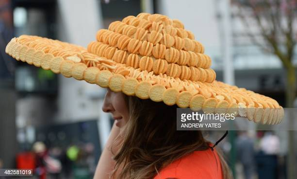 A model wears a hat made from cheese buscuits on 'Ladies Day' at the Grand National horse race meeting at Aintree in Liverpool northwest England on...