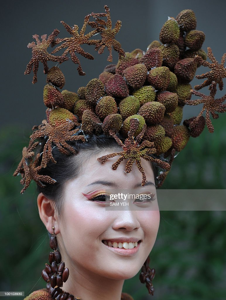 A model wears a lychee hat during a press conference in Taipei on May 21, 2010. The event was organized by Ksohisung county, southern Taiwan, government to promote the lychee festival which will fall on May 29 - 30. AFP PHOTO/Sam YEH