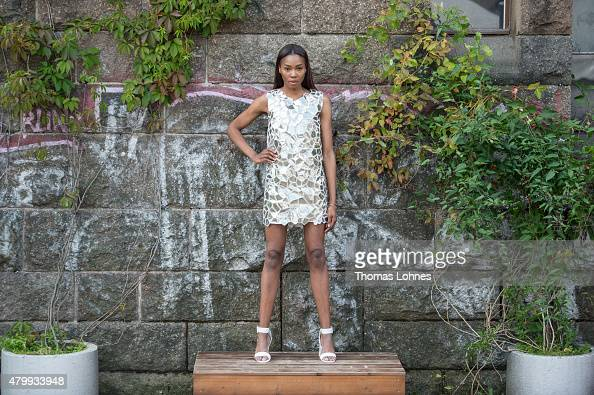 A model wears a metalic dress of the label Audiane Cojean at the 'Green Showroom' at 'Postbahnhof' on July 8 2015 in Berlin Germany Bigger than ever...