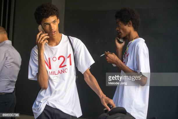 A model wears a N21 shirt and talks on the phone during Milan Men's Fashion Week Spring/Summer 2018 on June 19 2017 in Milan Italy
