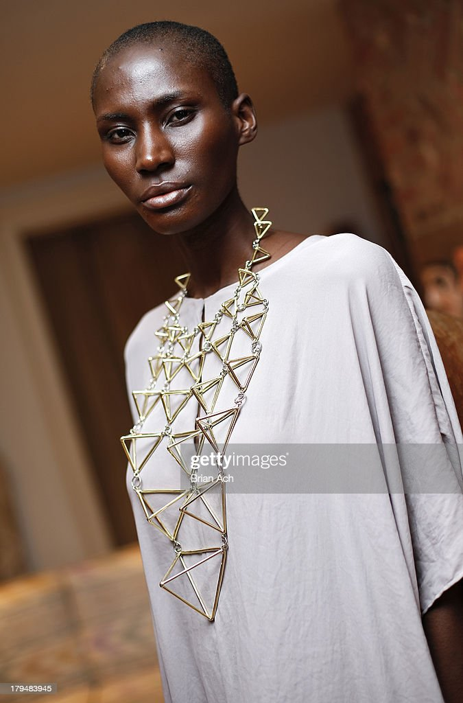 A model wears a necklace designed by Phoebe and Annette Stevens during the Anndra Neen presentation during Mercedes-Benz Fashion Week Spring 2014 at the Anndra Neen Atelier on September 4, 2013 in New York City.