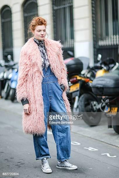 A model wears a pink fur coat a blue denim suit shoes and a bandanna outside the Jean Paul Gaultier show during Paris Fashion Week Haute Couture...
