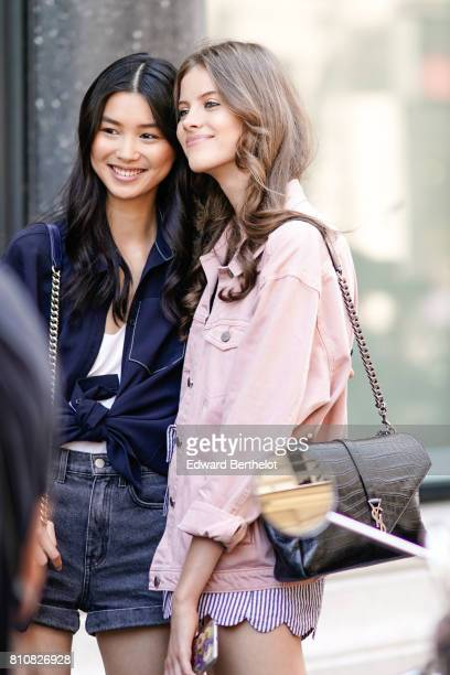 A model wears a pink jacket and a YSL bag outside the Elie Saab show during Paris Fashion Week Haute Couture Fall/Winter 20172018 on July 5 2017 in...
