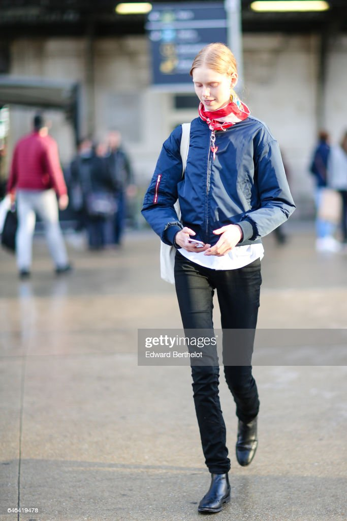 A model wears a red bandanna, and a blue bomber jacket, outside the Olivier Theyskens show, during Paris Fashion Week Womenswear Fall/Winter 2017/2018, on February 28, 2017 in Paris, France.