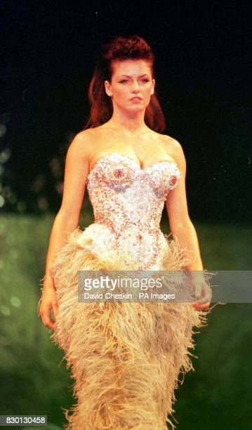 A model wears a strapless sequined bodice with ostrich plumb skirt from the Vivienne Westwood Spring/Summer collection at the Scottish Exhibition and...