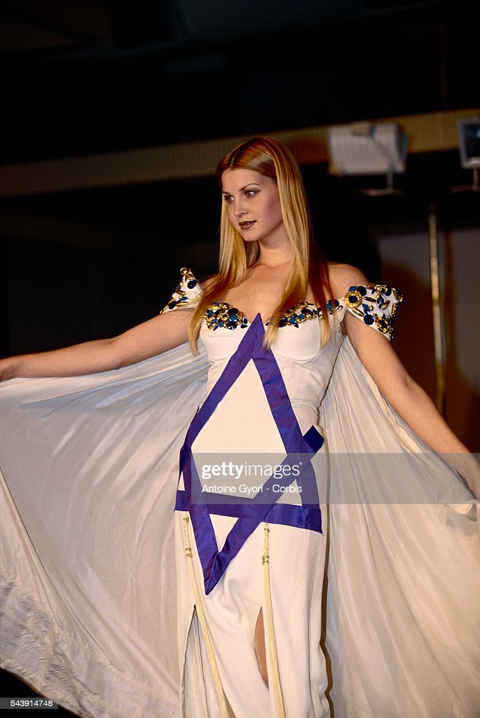 A model wears a wedding gown modeled on the Israeli flag at a fashion show in honor of Israel's 50th anniversary