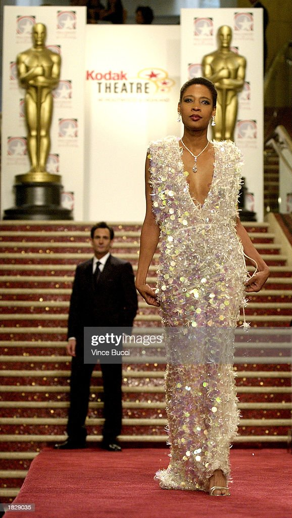 A model wears a white iridescent seguin gown by designer Lloyd Klein at the 2003 Oscar Fashion Preview at the Kodak Theatre on March 4, 2003 in Hollywood, California.