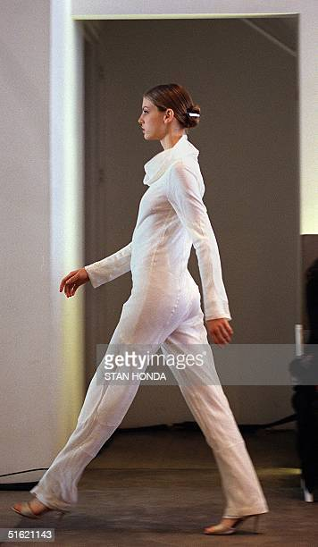 A model wears a white silk organza one piece outfit during the Helmut Lang fashion show 16 February in New York The show is part of the Women's/Men's...