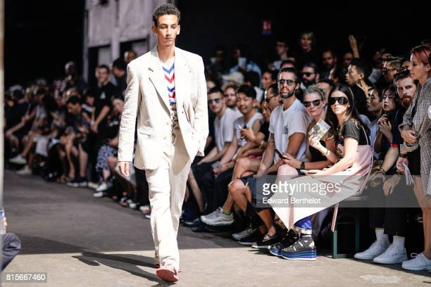 A model wears a white suit outside the Y/Project show during Paris Fashion Week Menswear Spring/Summer 2018 on June 21 2017 in Paris France