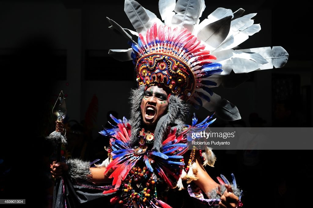 A model wears an Apache costume in the kids carnival during The 13th Jember Fashion Carnival 2014 on August 21, 2014 in Jember, Indonesia. The 13th Jember Fashion Carnival (JFC) 2014 theme is 'Triangle, Dynamic in Harmony' and consists of ten parades which include Mahabharata, Tambora, Phoenix, Pine Forest, Apache, Borobudur, Flying Kite, Wild Deers, Stalagmite, and Chemistry. This street carnival is claimed to be one of the biggest in the world and comprises more than 850 performers parading along 3.6 km road used as the catwalk.