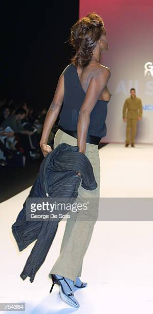 A model wears an outfit from the Gen Art Fall 2001 collection February 9 2001 on the second day of the MercedesBenz Fashion Week 2001 at Bryant Park...