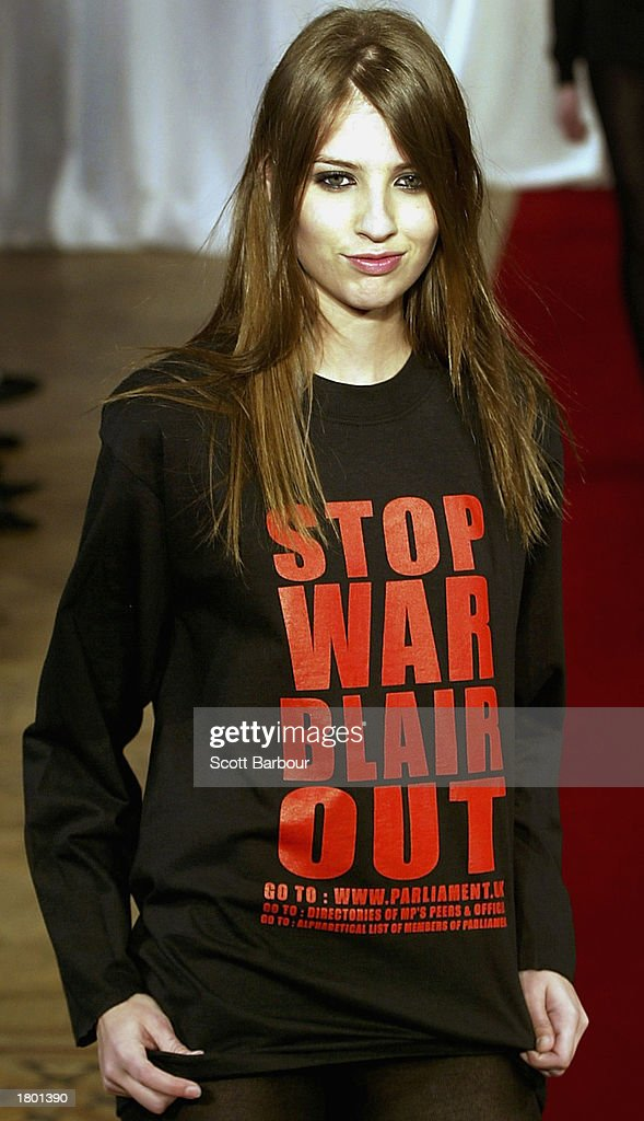 A model wears an outfit with 'Stop War Blair Out' written on it during the Katharine Hamnett Autumn/Winter 2003 show February 18, 2003 in London.