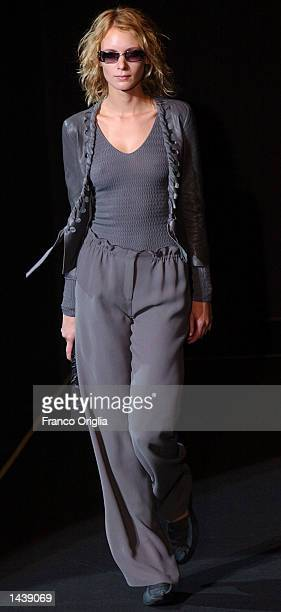 A model wears clothes from Italian designer Giorgio Armani for SpringSummer women's 2003 collection September 30 2002 in Milan Italy