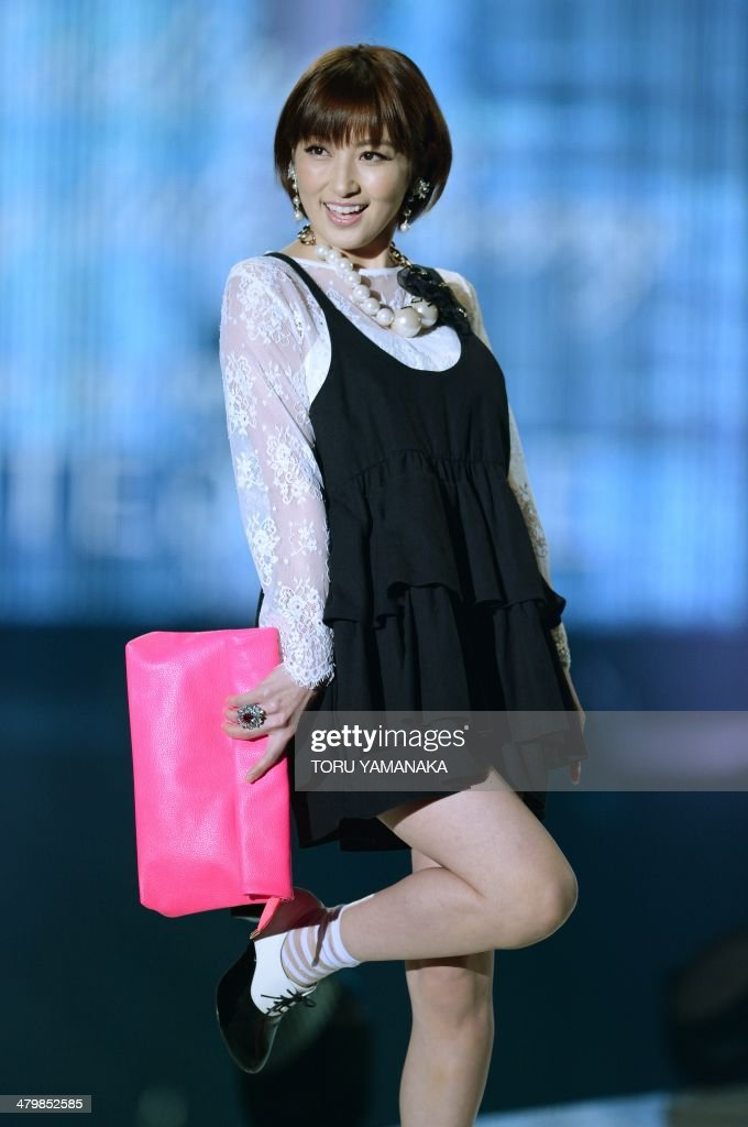 A model wears creations by Japanese fashion brand Darling by Little Berry during the Tokyo Runway 2014 spring summer collections in Tokyo on March 21, 2014. AFP PHOTO/Toru YAMANAKA