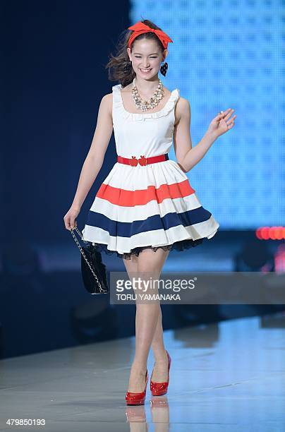 A model wears creations by Japanese fashion brand Honey Bunch during the Tokyo Runway 2014 spring summer collections in Tokyo on March 21 2014 AFP...