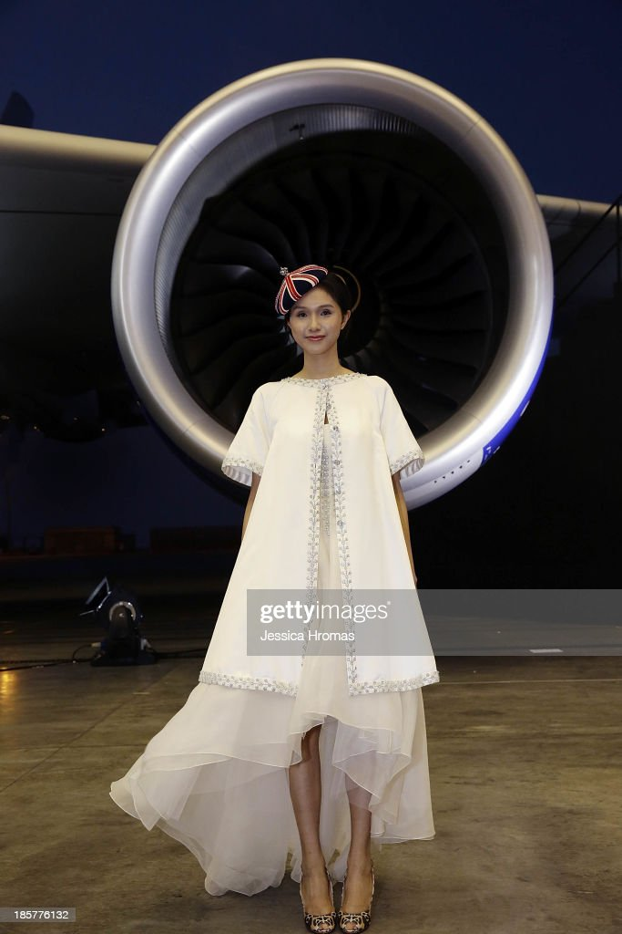 Model wears designs by acclaimed British designer Alice Temperley MBE, showing her Spring/Summer 2014 collection for British Airways launch of the A380 to Hong Kong 'Gig On A Wing' on October 24, 2013, Hong Kong.