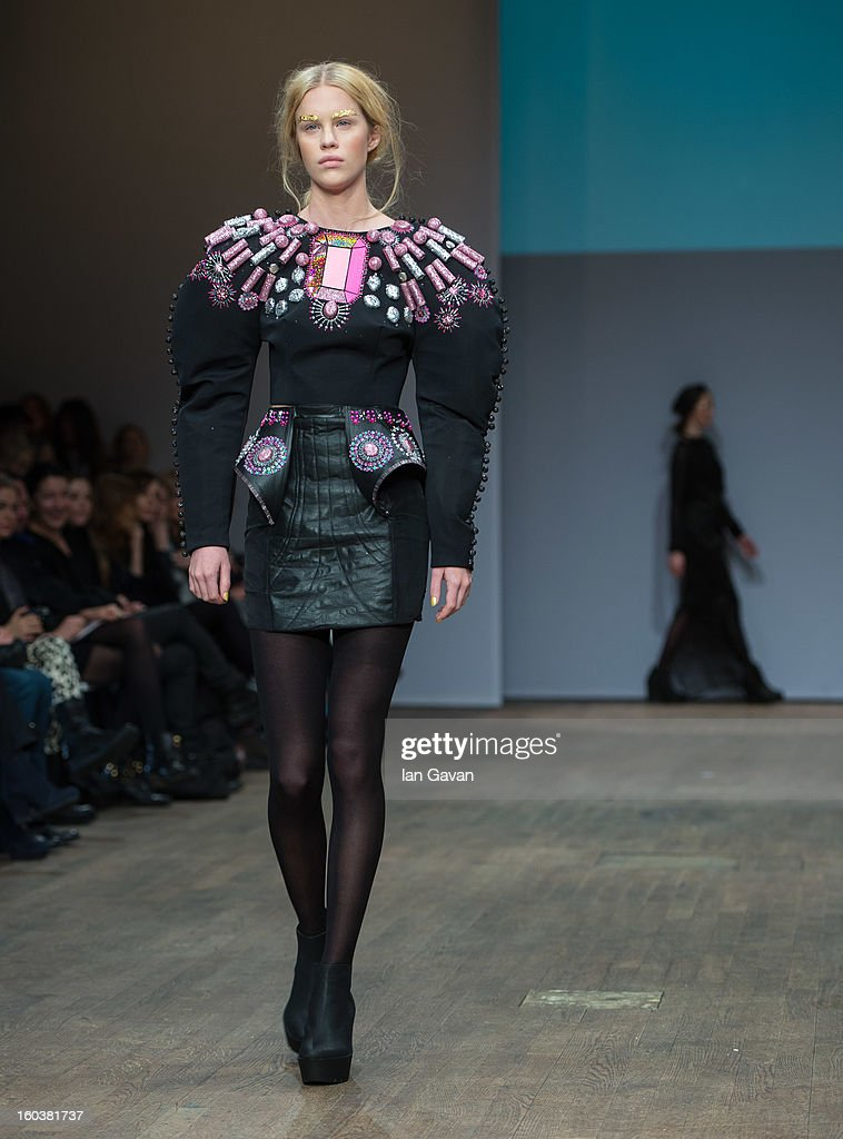 A model wears designs by Marita Ohman during the Beckmans College of Design show at Mercedes-Benz Stockholm Fashion Week Autumn/Winter 2013 at Berns on January 30, 2013 in Stockholm, Sweden.