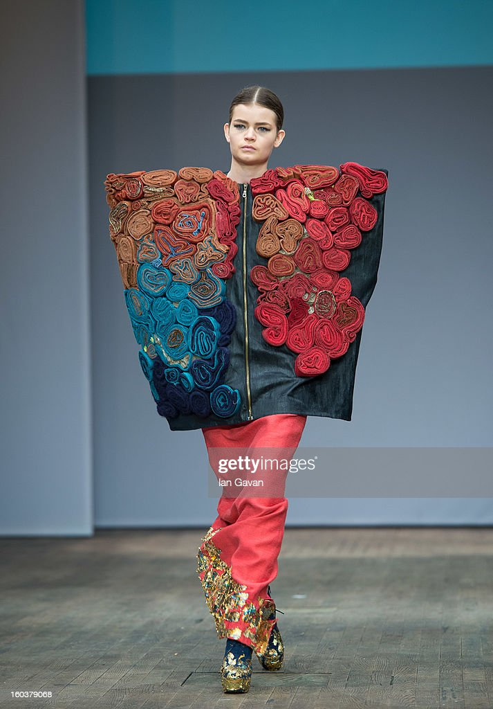 A model wears designs by Ulrika Runius during the Beckmans College of Design show at Mercedes-Benz Stockholm Fashion Week Autumn/Winter 2013 at Berns on January 30, 2013 in Stockholm, Sweden.