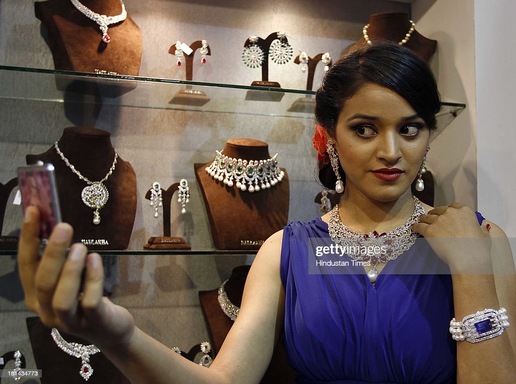 Global b2b jewellery and gem fair 2013 photos and images getty a model wears diamond necklace and earrings at a jewellery stand at the global b2b jewellery ccuart Choice Image