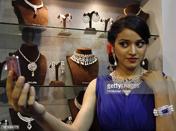 A model wears diamond necklace and earrings at a jewellery stand at the global B2B Jewellery and Gem Fair 2013 at Pragati Maidan on September 21 2013...