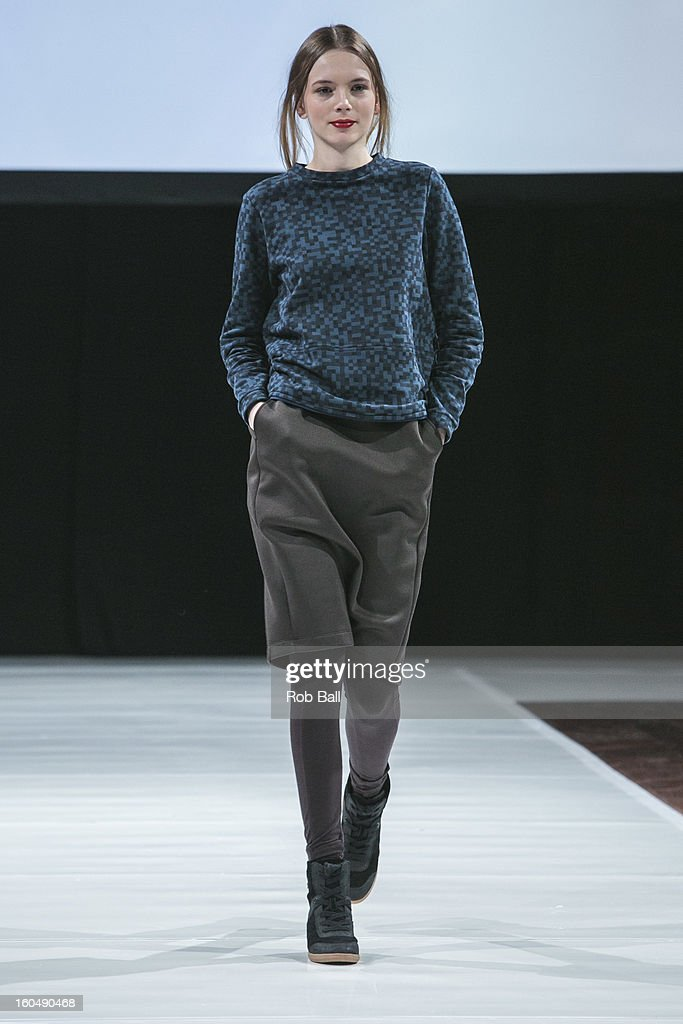 A model wears fashions by Dutch designer Ready To Fish during Day 3 of Copenhagen Fashion Week on February 1, 2013 in Copenhagen, Denmark.