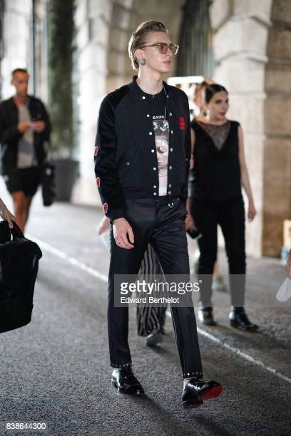 A model wears sunglasses a jacket black pants black shoes outside the Icosae show during Paris Fashion Week Menswear Spring/Summer 2018 on June 21...