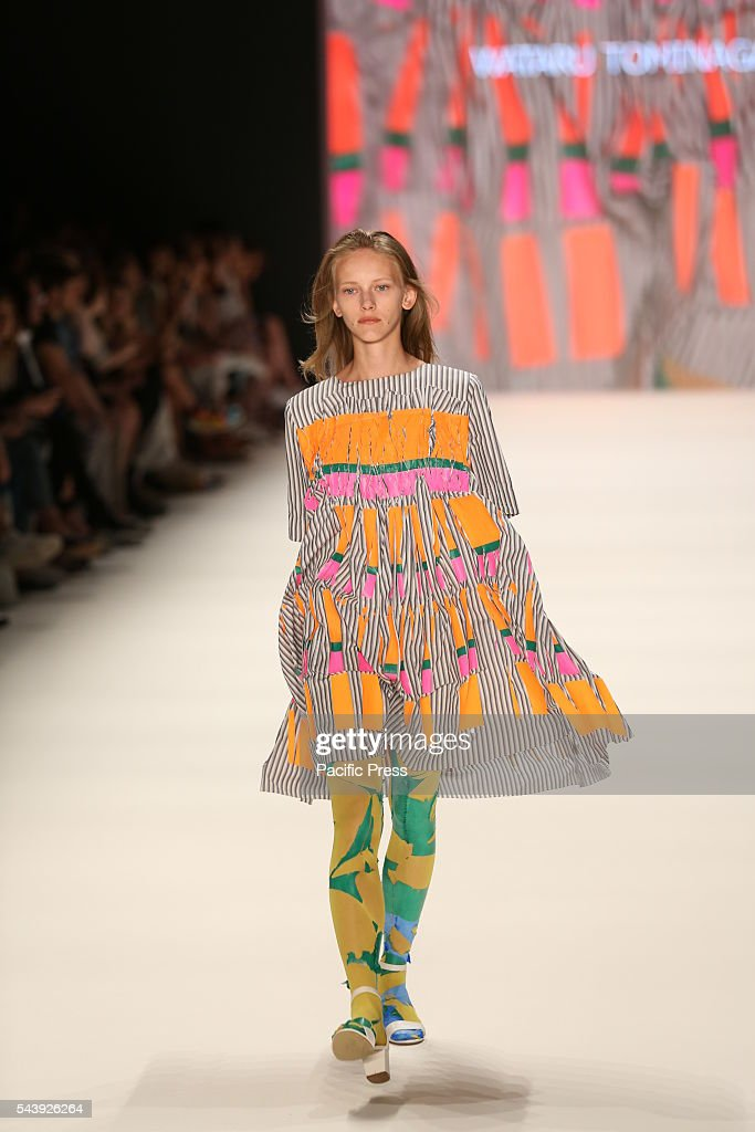 Model wears the collection of Wataru Tominaga during the catwalk in the Erika Hess Ice Stadium in Berlin-Wedding. Numerous labels are taking part in the German fashion week for the 2017 spring / summer season.