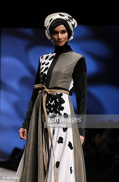 A model wears the designs of Lia Soraya with the theme 'Chronicle Of Dalmation' on the catwalk during the Indonesia Fashion Week 2016 at Jakarta...