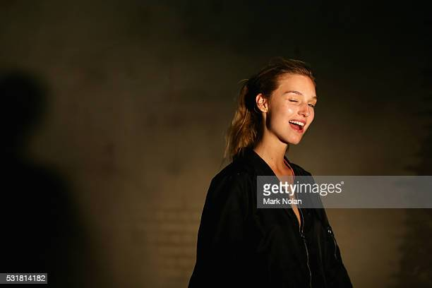 A model winks as she prepares backstage ahead of the Bec Bridge show at MercedesBenz Fashion Week Resort 17 Collections at Carriageworks on May 17...
