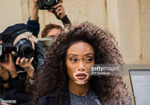 US model Winnie Harlow arrives before the Christian Dior women's 2018 Spring/Summer readytowear collection fashion show in Paris on September 26 2017...