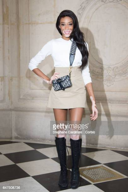 Model Winnie Harlow attends the Christian Dior show as part of the Paris Fashion Week Womenswear Fall/Winter 2017/2018 on March 3 2017 in Paris France