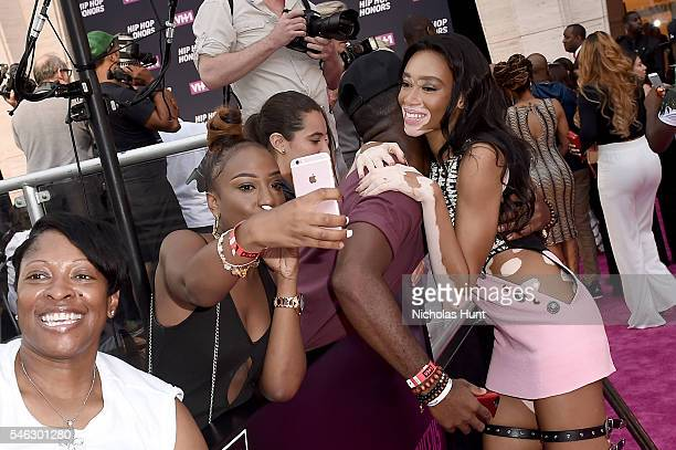 Model Winnie Harlow hugs a fan during the VH1 Hip Hop Honors All Hail The Queens at David Geffen Hall on July 11 2016 in New York City
