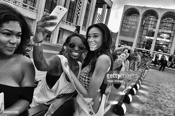 Model Winnie Harlow takes a selfie with a fan during the VH1 Hip Hop Honors All Hail The Queens at David Geffen Hall on July 11 2016 in New York City