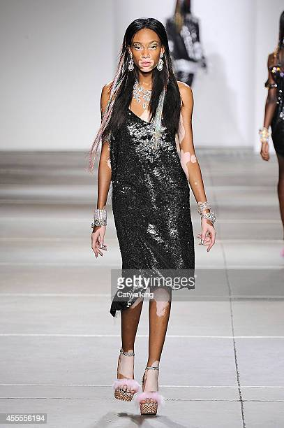 Model Winnie Harlow walks the runway at the Ashish Spring Summer 2015 fashion show during London Fashion Week on September 16 2014 in London United...