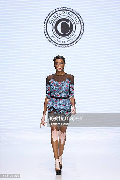 Model Winnie Harlow walks the runway for Michael Cinco during the Couturissimo Fall/Winter 20162017 show as part of Paris Fashion Week on July 3 2016...