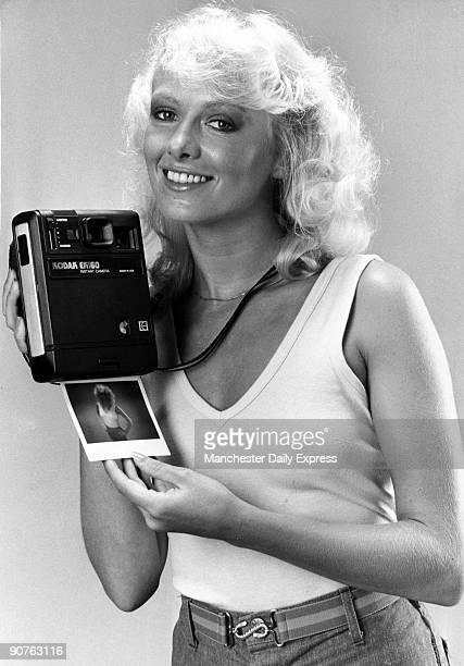 Model with a Kodak polaroid camera