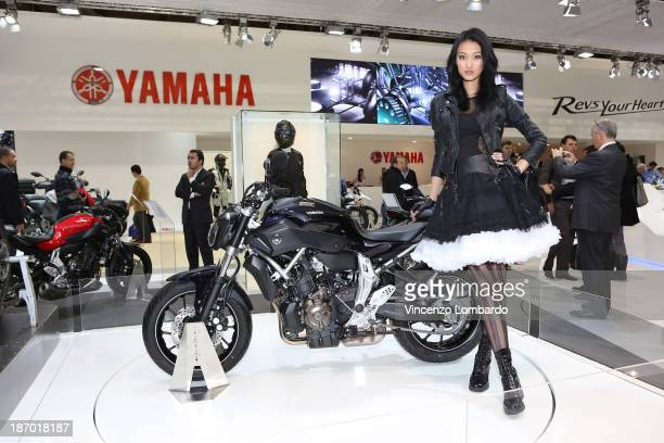 A model with a Yamaha motorbike during the 71st International Motorcycle Exhibition EICMA 2013 on November 5 2013 in Milan Italy