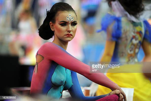 A model with artwork painted on her body attends a body art show at the Nevskie Berega international art festival in the Russia's second city of...