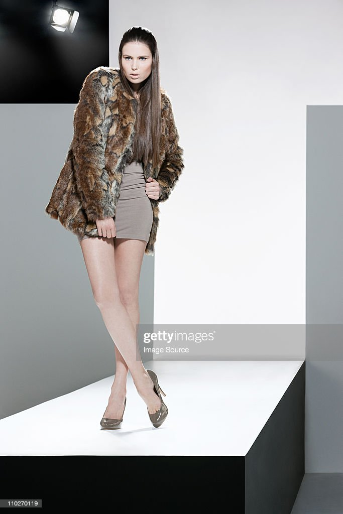Model with fur coat on catwalk at fashion show : Stock Photo
