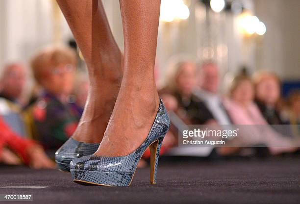 Model with highheeled shoes on the runway during Liz Malraux Fashion Show at Hotel Atlantic on February 17 2014 in Hamburg Germany
