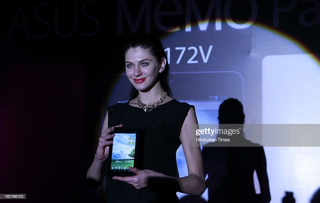 Model with newly unveiled ASUS MeMO Pad 172V on February 27, 2013 in New Delhi, India. The tablet is powered with 1GHz processor and 1GB RAM. It comes with 8GB internal memory with support for an expandable memory card slot. The device is priced at Rs 9,999.