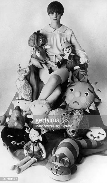 Model with rag dolls and cushions in the shape of animals