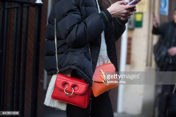 A model with two JW Anderson bags on day 2 of the London Fashion Week February 2017 collections on February 18 2017 in London England