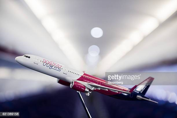 A model Wizz Air Holdings Plc aircraft stands onboard a passenger aircraft in this arranged photograph at Liszt Ferenc airport in Budapest Hungary on...